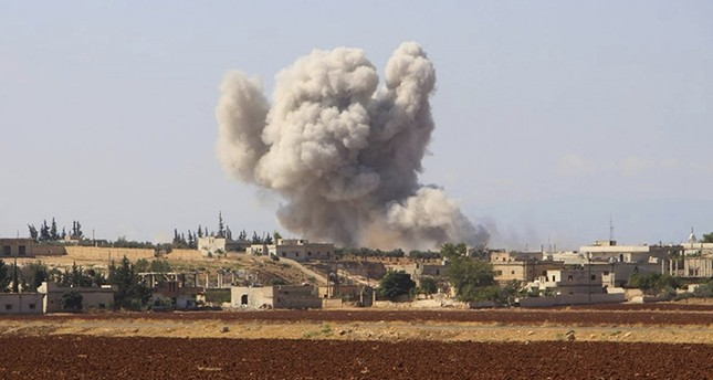 This file photo released on Sept. 10, 2018, by the The White Helmets shows smoke rising from an Assad regime airstrike in Hobeit Village near Idlib, Syria. (Syrian Civil Defense White Helmets via AP)