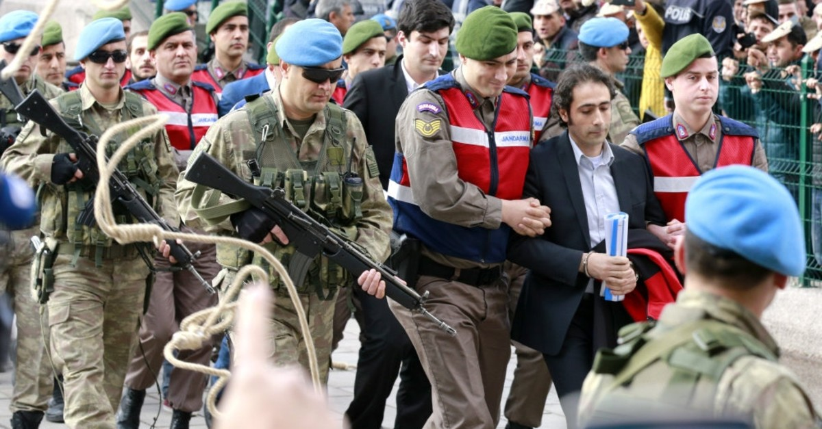 Protesters hurl nooses at defendants as troops escort defendants in another case related to the putschist takeover of Special Forces Command in Ankara, March 21, 2017.