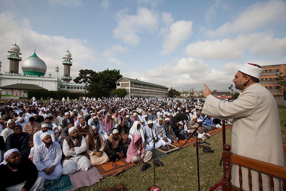 Muslims listen to a sermon from the Imam outside Masjid Noor mosque in Nairobi, Kenya