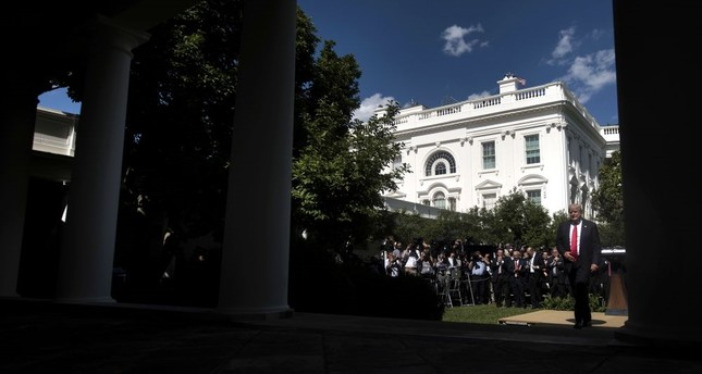 U.S. President Donald Trump leaving after announcing the decision to withdraw the U.S. from the Paris climate agreement in the Rose Garden of the White House in Washington, D.C. on Thursday.