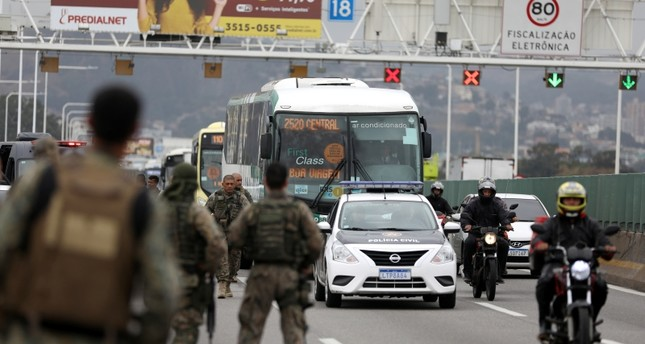 Police officers are seen on the Rio-Niteroi Bridge, where security forces shot dead a man who hijacked a commuter bus in Rio de Janeiro, Brazil August 20, 2019. (Reuters Photo)