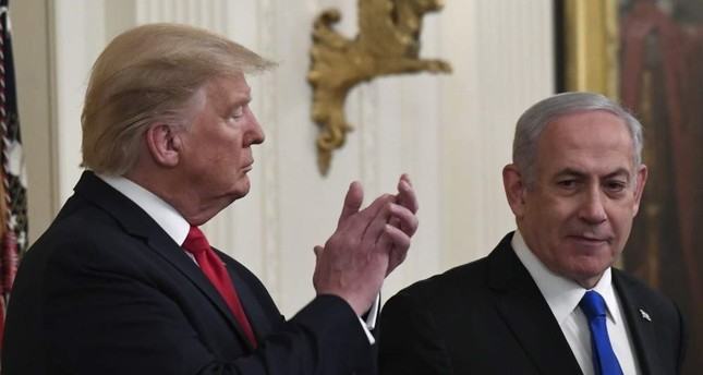 The U.S. President Donald Trump listens as Israeli Prime Minister Benjamin Netanyahu speaks during an event in the East Room of the White House, Washington, D.C., Jan. 28, 2020. AP Photo