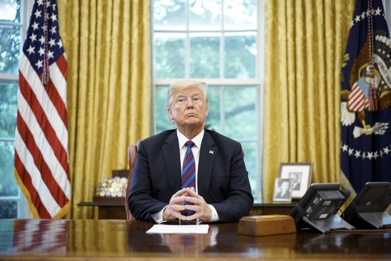 In this file photo taken on August 27, 2018, US President Donald Trump listens during a phone conversation with Mexico's President Enrique Pena Nieto on trade in the Oval Office of the White House in Washington, DC. (AFP Photo)