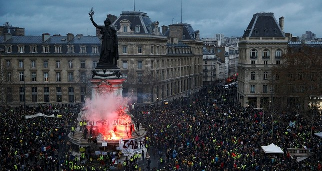 A view of the Place de la Republique as protesters wearing yellow vests gather during a national day of protest by the yellow vests movement in Paris, France, Dec. 8.