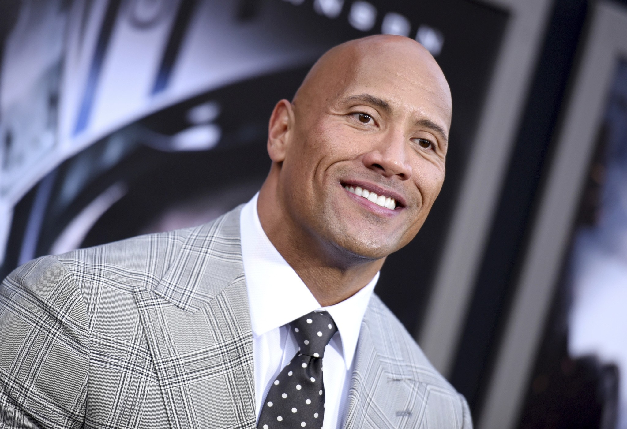 In this May 26, 2015, file photo, Dwayne Johnson arrives at the premiere of ,San Andreas, at the TCL Chinese Theatre in Los Angeles. (AP Photo)