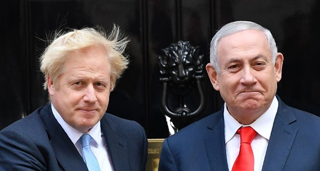 Britain's Prime Minister Boris Johnson (L) greets Israel's Prime Minister Benjamin Netanyahu outside 10 Downing Street, London, Sept. 5, 2019.