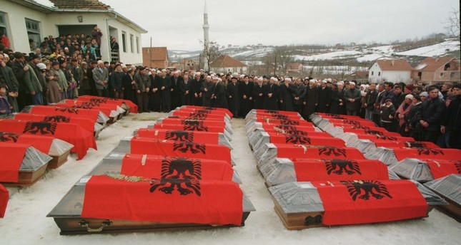 The coffins of 40 ethnic Albanians in the village of Racak before a funeral during the Kosovo War of 1998 – 1999.