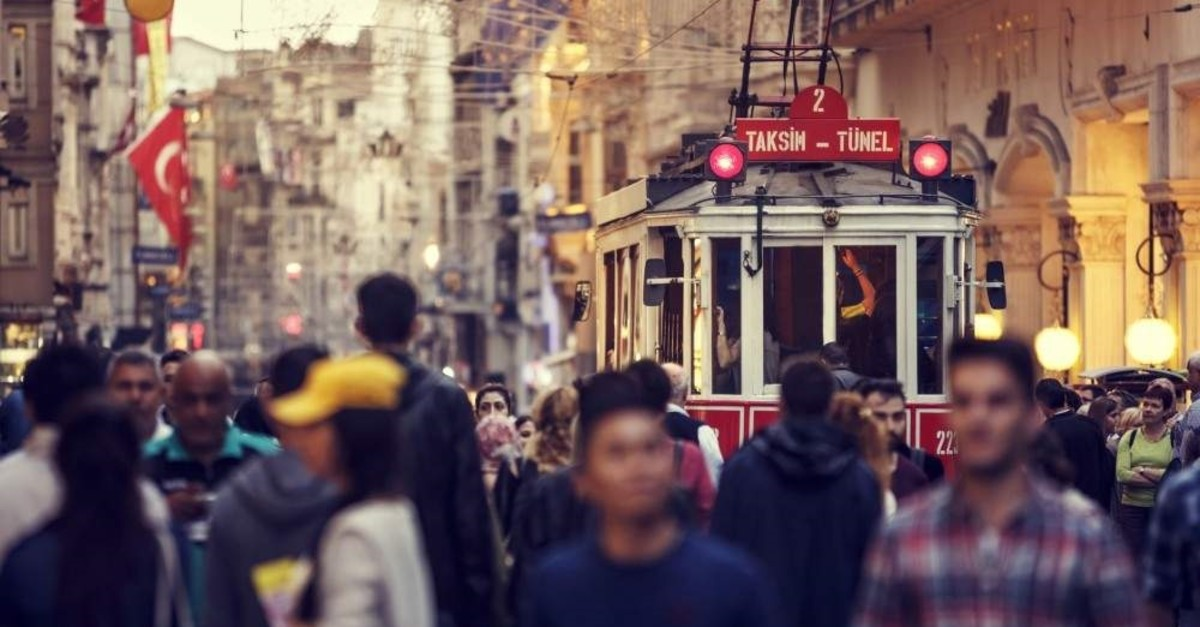 A tram passes through the large crowded Istiklal Street in Taksim, Istanbul. (iStock Photo / Damir Cudic)