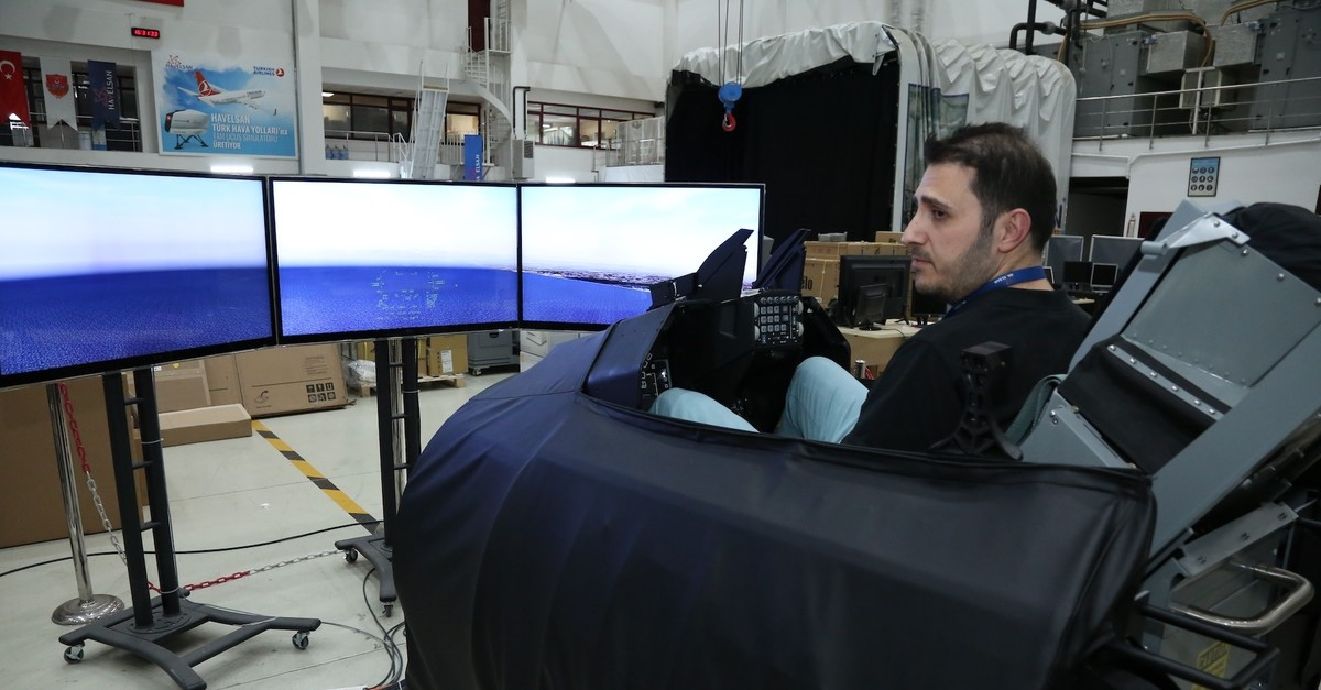 A HAVELSAN engineer responsible for system integration tests the F-16 training simulator.