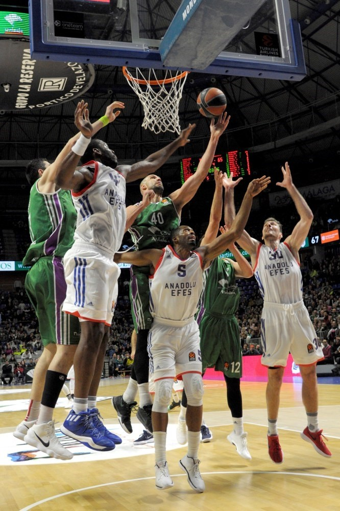 Unicajau2019s James Augustine (3-L) vies for the ball against Anadolu Efesu2019 Bryant Dunston (2-L) and Derrick Brown (4-L) during the EuroLeague basketball game on Feb. 8.