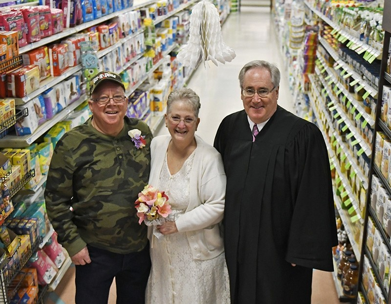 Larry Spiering and Becky Smith pose for a photo where they held their wedding ceremony officiated by District Judge Frank Pallone on Easter Sunday in aisle 13 of the Community Market in Lower Burrell, Pa. (AP Photo)