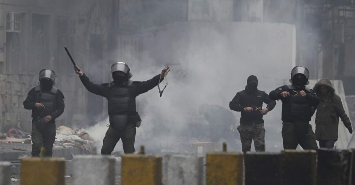Security forces prepare to use slingshots to disperse anti-government protesters during clashes in central Baghdad, Feb. 16, 2020. (AP Photo)
