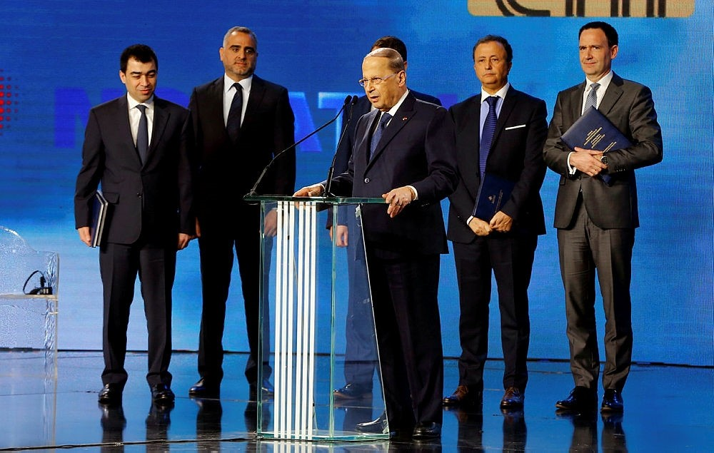 Lebanese President Michel Aoun, center, speaks during the signing ceremony with an international consortium to start exploratory offshore drilling for oil and gas in Beirut, Lebanon, Friday, Feb. 9, 2018. (AP Photo)
