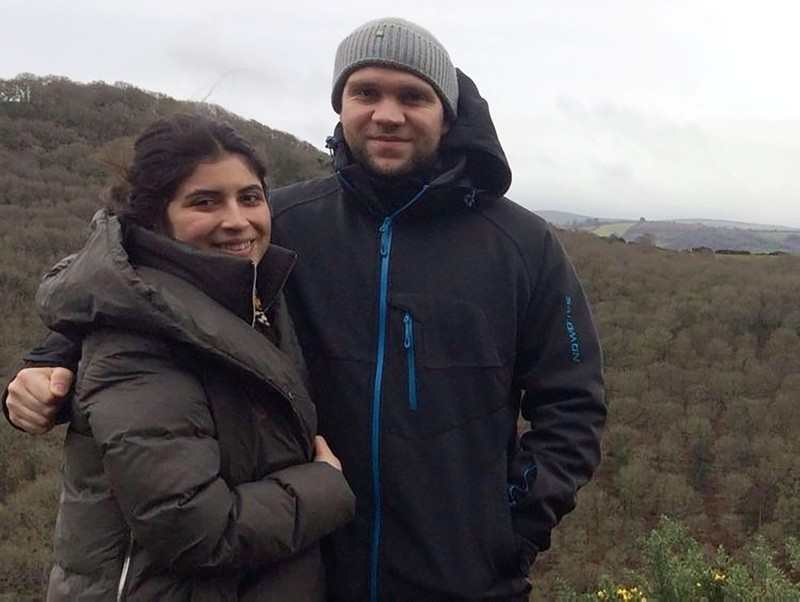This file handout photo released by the family of British student Matthew Hedges via the Detained in Dubai organisation on October 11, 2018 shows him (R) and his wife Daniela Tejada (L) posing in an undisclosed location. (AFP Photo)