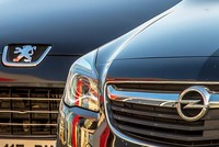General Motors Co. is selling its loss-making European car business — including Germany's Opel and British brand Vauxhall — to French automaker PSA group.  The 2.2 billion euro ($2.33...