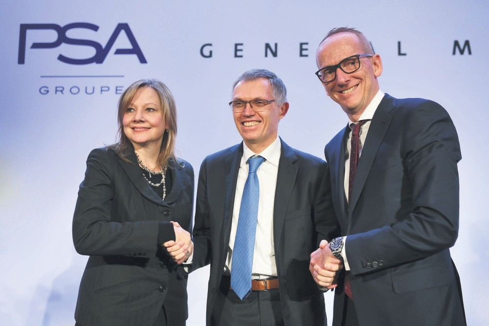GM CEO Mary T. Barra, chairperson of the managing board of PSA Tavares and Opel CEO Neumann shake hands during a press conference about the acquisition by PSA of GMu2019s European subsidiary, which includes Opel and Vauxhall in Paris on March 6, 2017.