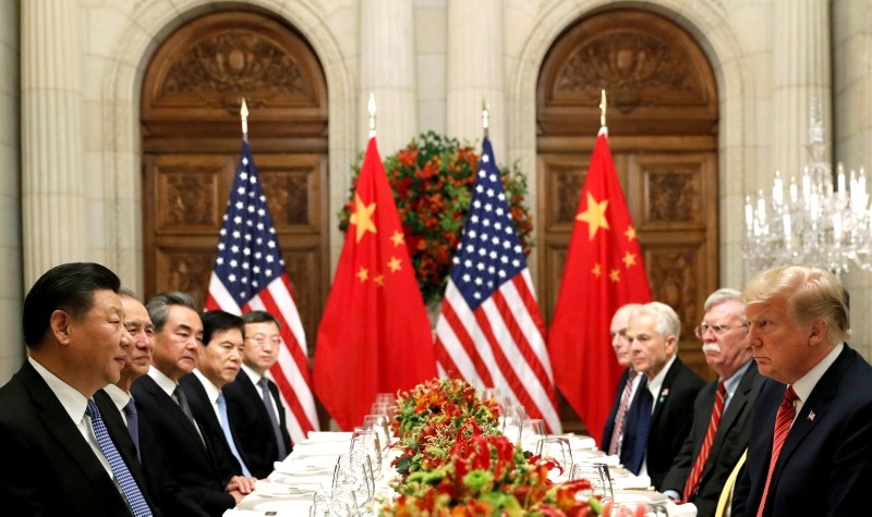 U.S. President Trump, U.S. Secretary of State Mike Pompeo, national security adviser John Bolton and Chinese President Xi Jinping at a working dinner after the G20 leaders summit in Buenos Aires on Dec. 1, 2018. (REUTERS Photo)
