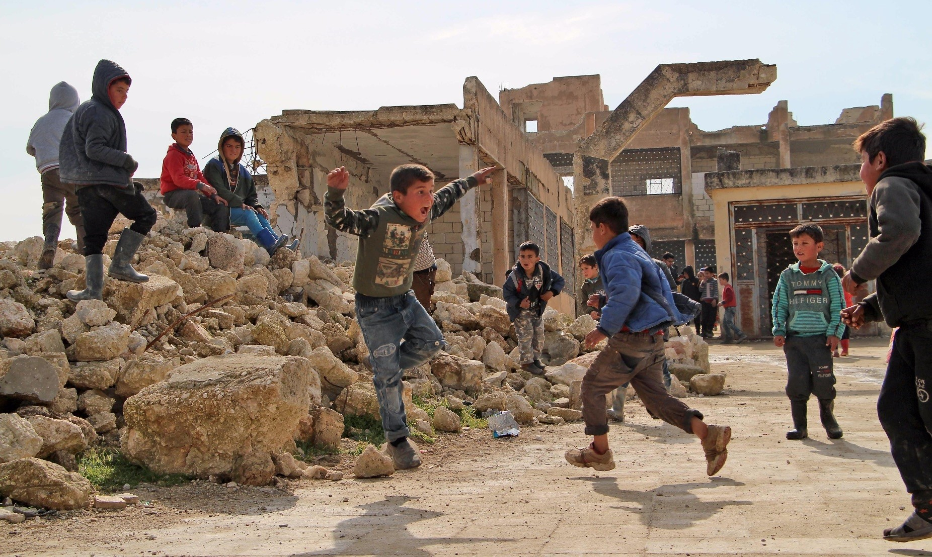 Children play in the yard of a school that was partially destroyed during battles in the village of Kufayr, in Syriau2019s Idlib Governorate, Feb. 4, 2019.