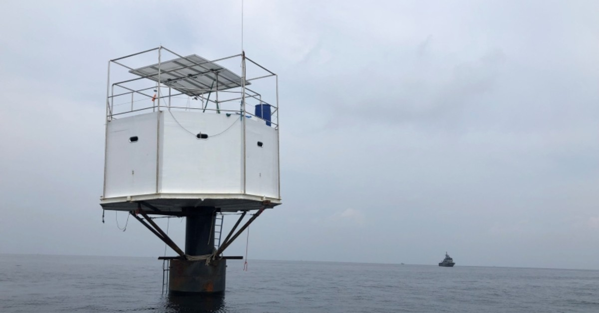 A floating home, lived in by an American man and his Thai partner, is pictured in the Andaman Sea, off Phuket island in Thailand, April 13, 2019. Picture taken April 13, 2019. (Royal Thai Navy/Handout via Reuters)