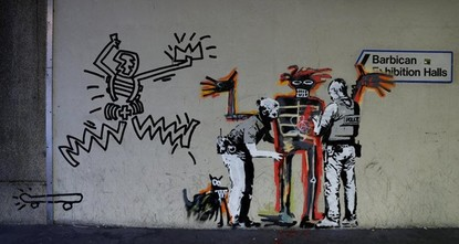 pTwo murals by British street artist Banksy have appeared at London's Barbican centre to mark an exhibition of the work of Jean-Michel Basquiat, a U.S. artist who achieved fame through the New York...