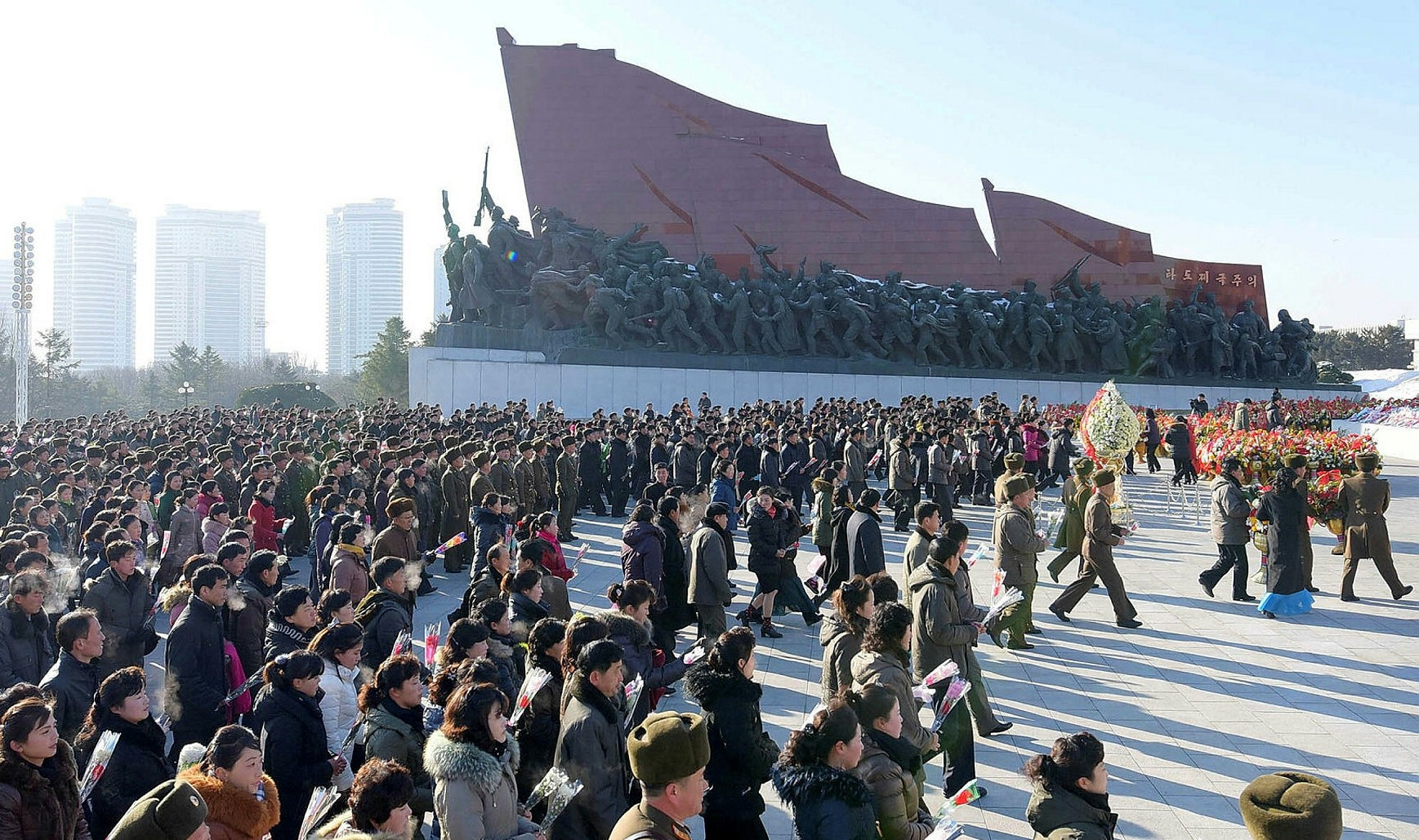 Servicepersons and civilians of the DPRK visit the statues of President Kim Il Sung and leader Kim Jong Il on the occasion of the greatest memorial day of the nation, in this photo released by KCNA in Pyongyang December 17, 2017. (KCNA via Reuters)
