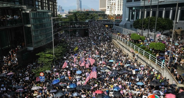 Protesters wave US flags as they march in Hong Kong on September 8, 2019, to call on the US to pressure Beijing to meet their demands and for Congress to pass a recently proposed bill that expresses support for the protest movement. AFP Photo