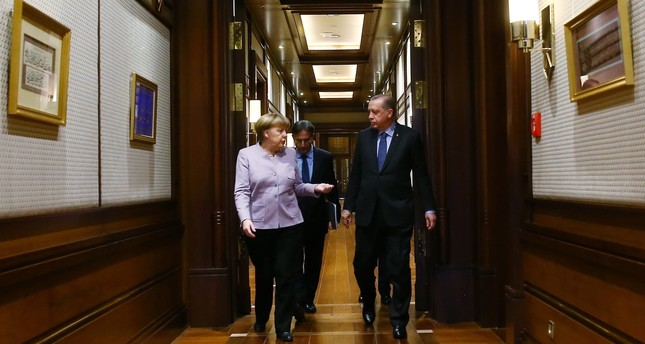President Recep Tayyip Erdoğan and German Chancellor Angela Merkel arrive for a press statement after a meeting in Ankara, Feb. 2.