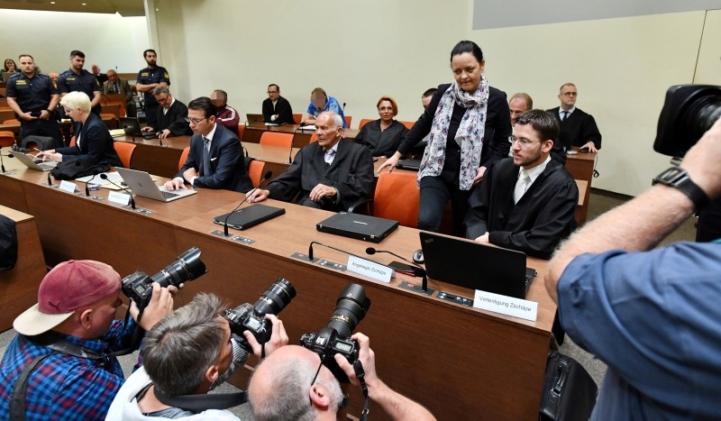 Defendants Beate Zschaepe, Andre E. (2nd row, 2-R) and Holger G. (3rd row, 2-L)  wait for the start of the 437th day of the NSU trial at the higher regional court (Oberlandesgericht, OLG) in Munich, Germany, 03 July 2018. (EPA Photo)
