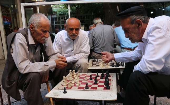 The regulars of the Chess Coffee Shop in Siirt contemplate their next move.