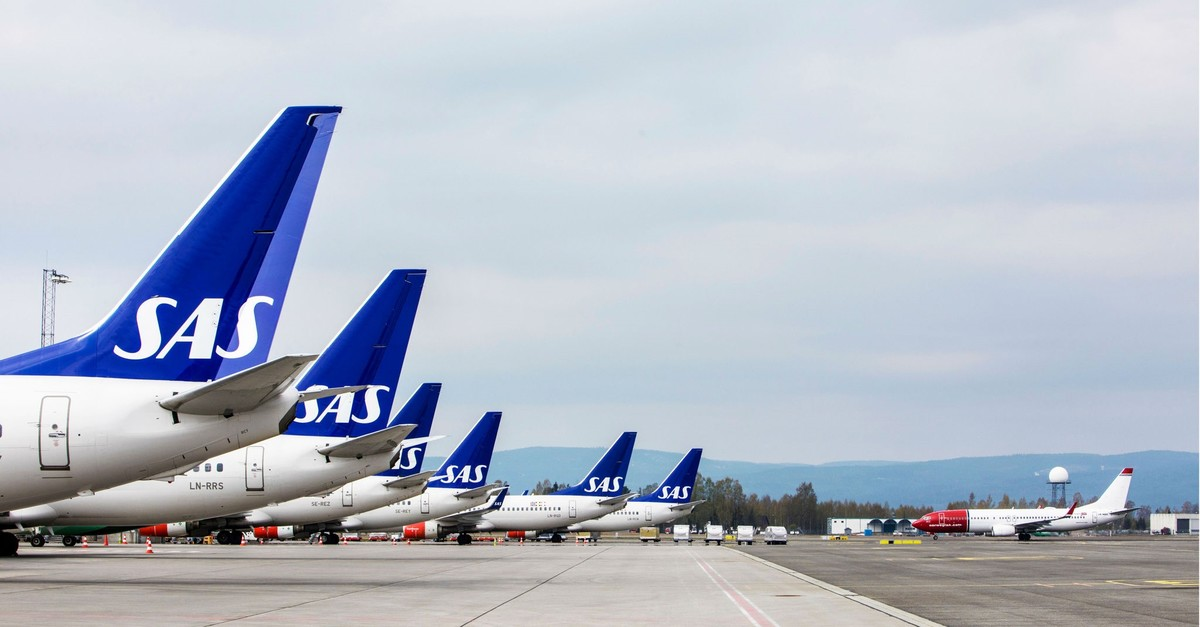 Airplanes of the Scandinavian Airlinesu2019 SAS company park on ground at the Gardamoen Airport during a strike of pilots to contest wages and working hours on April 26, 2019 in Oslo, Norway. (AFP Photo)