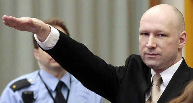Convicted mass killer Anders Behring Breivik gestures as he enters the court room in Skien prison, Norway, 15 March 2016. (EPA Photo)