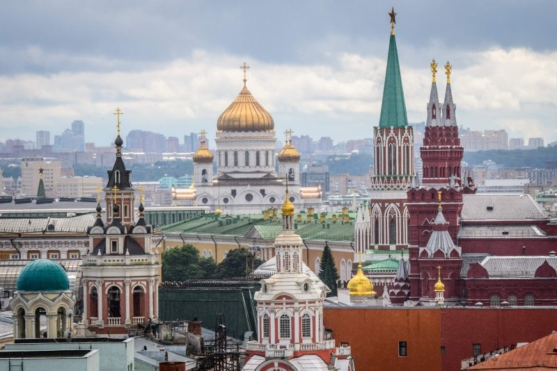 This photo taken on July 8, 2018 shows the Kremlin and the Cathedral of Christ the Saviour (C-Back) in Moscow. (AFP PHOTO)
