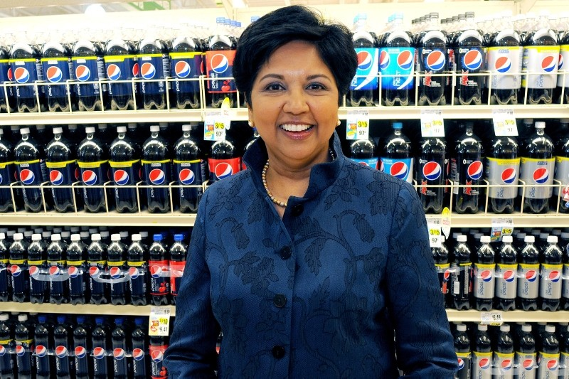 PepsiCo CEO Indra Nooyi poses for a portrait by products at the Tops SuperMarket in Batavia, New York, U.S. on June 3, 2013. (REUTERS Photo)