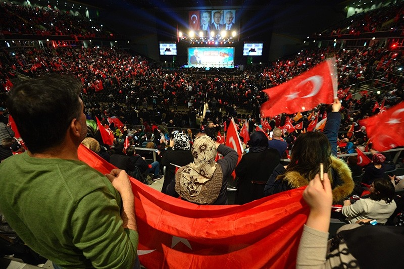 People wave Turkish flags during a campaigning event with the Turkish Prime Minister Binali Yu0131ldu0131ru0131m in Oberhausen, western Germany, on Feb. 18, 2017.