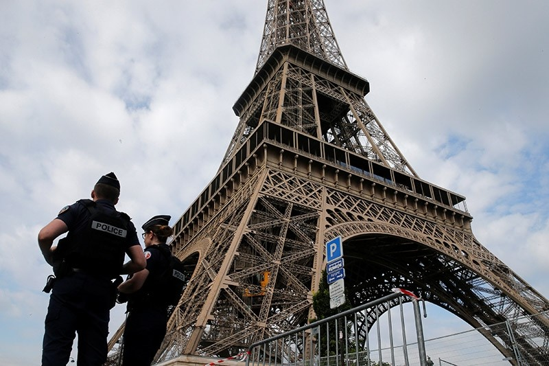 French police patrol near the Eiffel tower as part of security measures in Paris, France, July 13, 2017. (Reuters Photo)