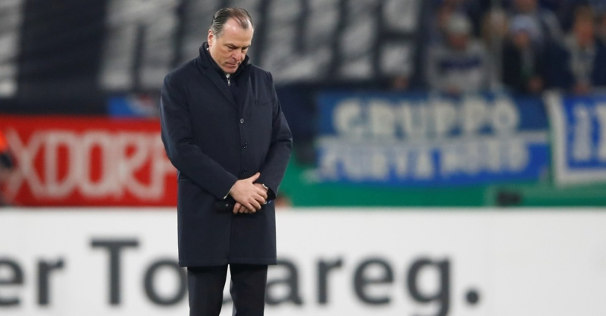 Clemens Toennies, president of German's first division Bundesliga soccer club Schalke 04 stands on the pitch during a minute of silence for late team manager Rudi Assauer at the Veltins Arena in Gelsenkirchen, Germany, February 6, 2019. (Reuters)