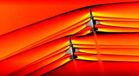 This handout colorized composite image released by NASA on February 7, 2019 shows two T-38 aircrafts flying in formation at supersonic speeds producing shockwaves that are typically heard on the ground as a sonic boom. (AFP Photo)