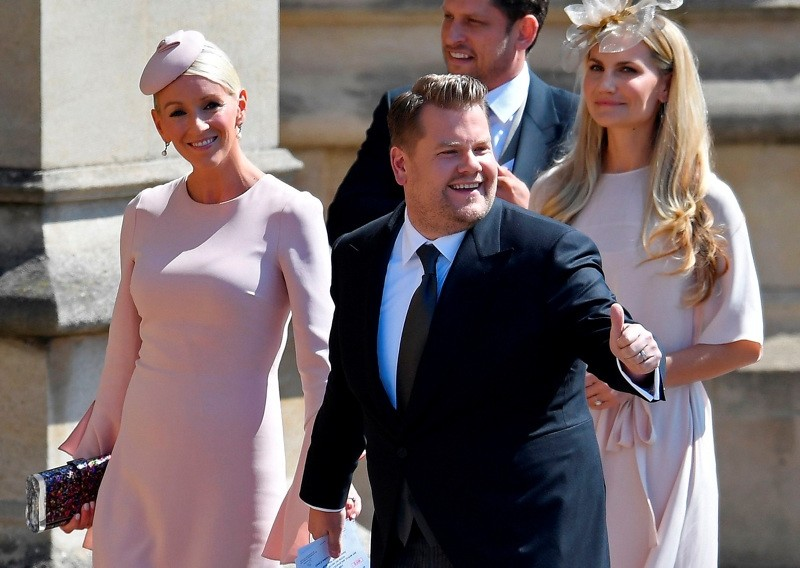 British presenter James Corden and Julia Carey arrive for the wedding ceremony of Britain's Prince Harry, Duke of Sussex and US actress Meghan Markle at St George's Chapel, Windsor Castle, in Windsor, on May 19, 2018.