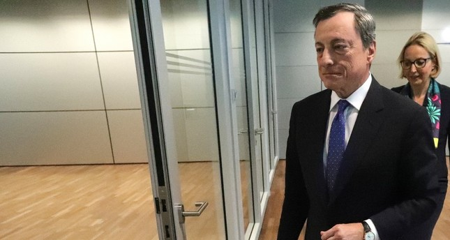 The President of the European Central Bank (ECB), Mario Draghi, leaves after a press conference in Frankfurt.