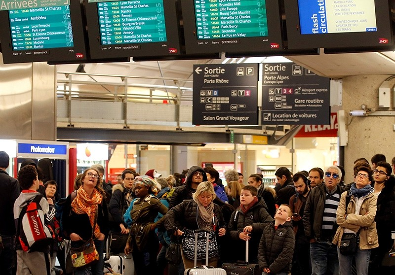 Passengers look at information boards at the Lyon Part-Dieu train station in Lyon (Reuters Photo)