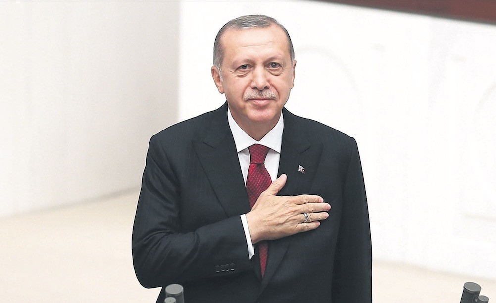 President Recep Tayyip Erdou011fan greets lawmakers at Parliament after taking the oath of office for the new legislative year of the 27th term, yesterday, Ankara.