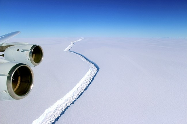A rift across the Larsen C Ice Shelf that had grown longer and deeper is seen during an airborne surveys of changes in polar ice over the Antarctic Peninsula from NASAu2019s DC-8 research aircraft on November 10, 2016. (Photo courtesy of NASA)
