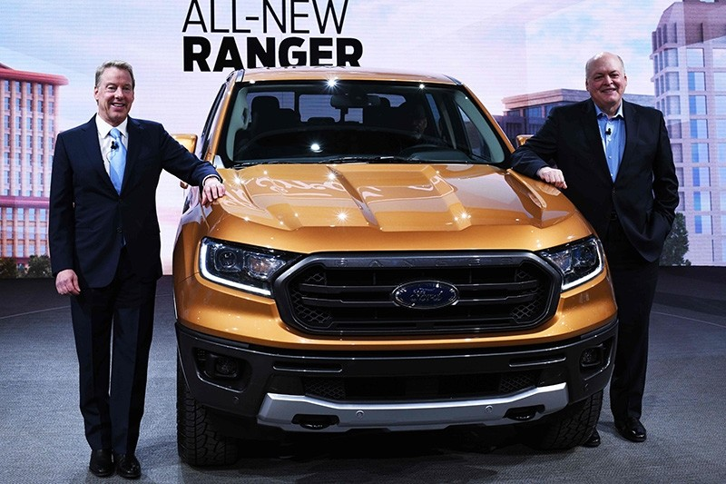 Bill Ford (L), executive chairman of the Ford Motor Company, and Jim Hackett (R), President and CEO, pose with the 2019 Ford Ranger at the 2018 North American Int'l Auto Show (NAIAS) in Detroit, Michigan, on Jan. 14, 2018. (AFP Photo)