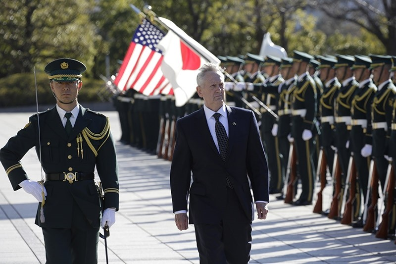 U.S. Defense Secretary Jim Mattis, right, is escorted to inspect an honor guard at Defense Ministry in Tokyo, Japan. Feb. 4, 2017. (AP Photo)