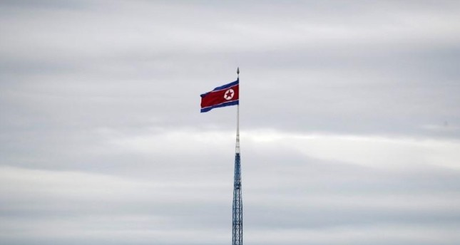 A North Korean flag flutters on top of a 160-metre tower in North Korea's propaganda village of Gijungdong (Reuters Photo)