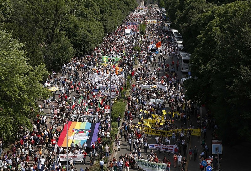 People march in downtown Milan, Italy, Saturday, May 20, 2017 as the take part to a demonstration in support of migrants' rights. (AP Photo)