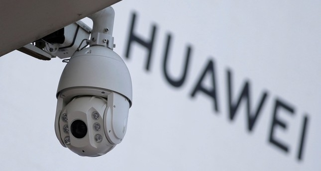 A surveillance camera is seen next to a sign of Huawei outside a shopping mall in Beijing, China January 29, 2019. (Reuters Photo)