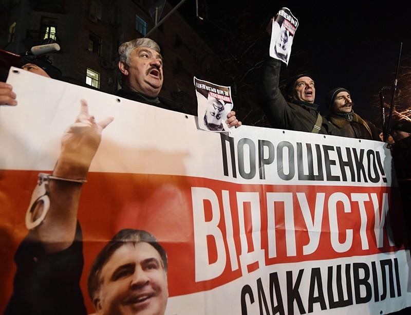 Supporters of former Georgian President Mikheil Saakashvili demonstrate holding a banner reading ,Poroshenko release Saakashvili, in front of the Ukrainian President Petro Poroshenko's office, in Kiev, Ukraine, Feb. 12, 2018. (AFP Photo)
