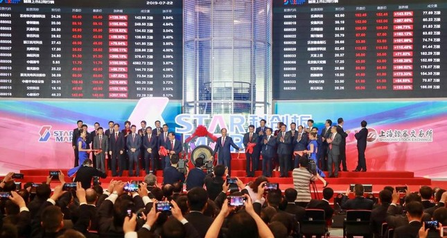 People take pictures during an opening ceremony of the Shanghai Stock Exchange's Sci-Tech Innovation Board, Shanghai, July 22, 2019.