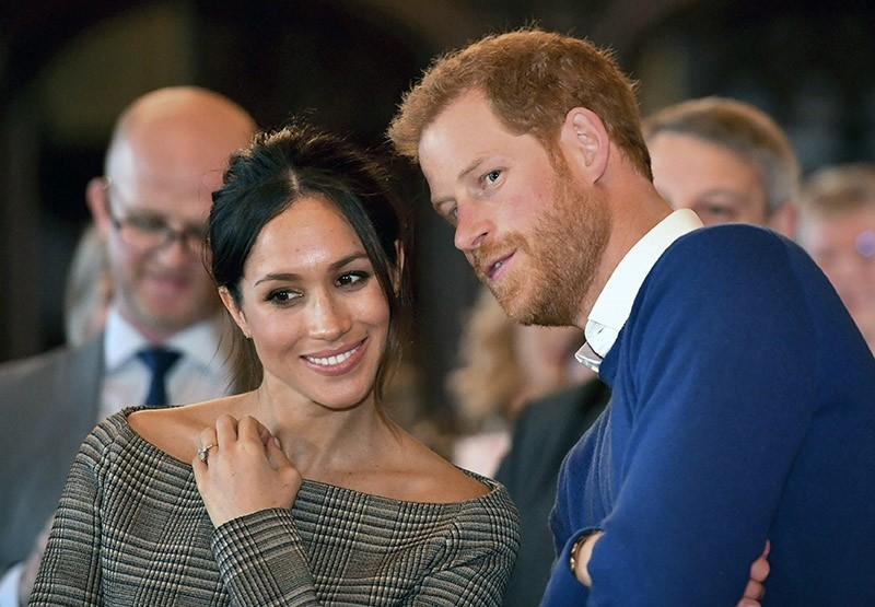 In this Thursday Jan. 18, 2018 file photo, Britain's Prince Harry talks to Meghan Markle as they watch a dance performance by Jukebox Collective in the banqueting hall during a visit to Cardiff Castle, Wales. (AP Photo)